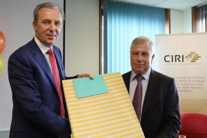 CIF President Michael Stone  (L) presents Joe O'Brien with a retirement gift from CIF staff.